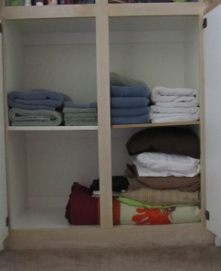 Studio Em Interiors - Get Organized - Linen Closet - Lower Section Organized