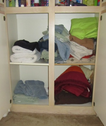 Studio Em Interiors - Get Organized - Linen Closet - Lower Section