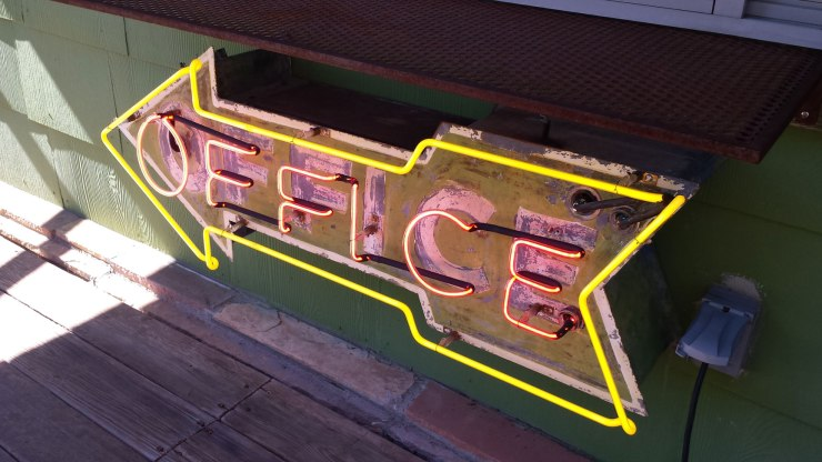 Loved the neon office sign on the community porch!