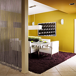 Add a metallic element with metal curtains to divide a space (image via)