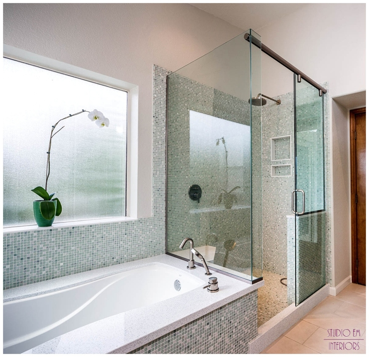 We created a large tub/shower area and unified the space by carrying the same calming mosaic tile throughout the entire space.