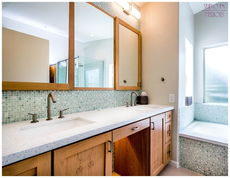 The mosaic tile used in the tub/shower area is used again to add a striking baksplash at the vanity. This adds to the calming spa like feel of the space.